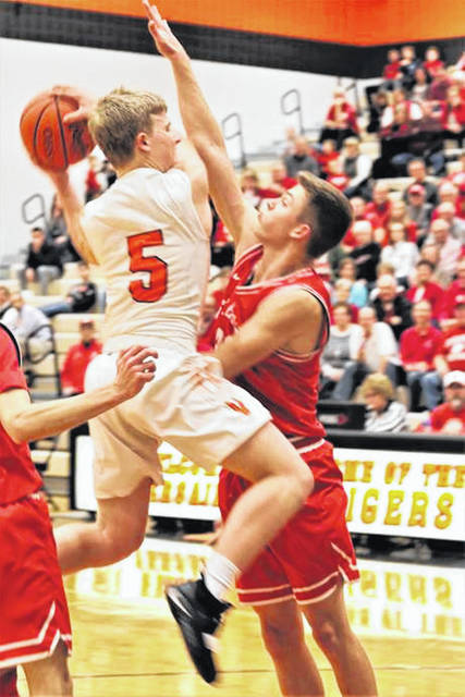 Michael Stammen draws a foul driving to the basket in Versailles win over St. Henry.