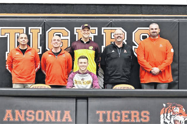 Brock Shellhaas is joined with coaching staff and school administration (L-R) Craig Riethman (girls track coach), Clint Neal (boys track coach), Steve Shellhaas (pole vault coach), James Robson Jr. (HS Principal) and Matt Macy (athletic director and football coach).