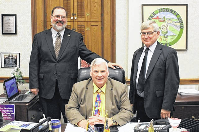 Commissioners, left to right, Matt Aultman, Mike Stegall and Mike Rhoades approved the county's 2020 budget on Monday.
