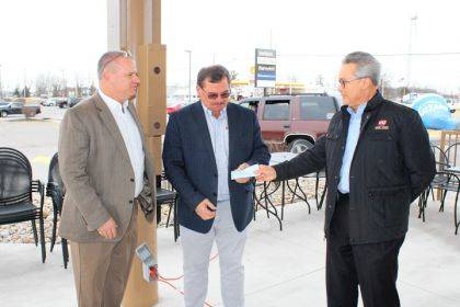 Mike Bowers and Steve Willman, board members for the Greenville Boys & Girls Club, accepted a check from Keith Chamber, Dairy Queen franchisee spokesperson.