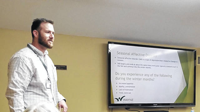 Bethany J. Royer-DeLong | Darke County Media Jordan D. Francis, MPH, Director of Wellness Services for Wayne HealthCare, provided information on Seasonal Affect Disorder or SAD during the Greenville Public Lunch and Learn on Wednesday.