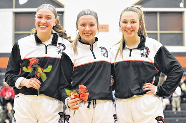 Arcanum Lady Trojans seniors (L-R) Kayla O'Daniel, Elliana Sloan and Gracie Garno are honored prior to the team's win over Newton.
