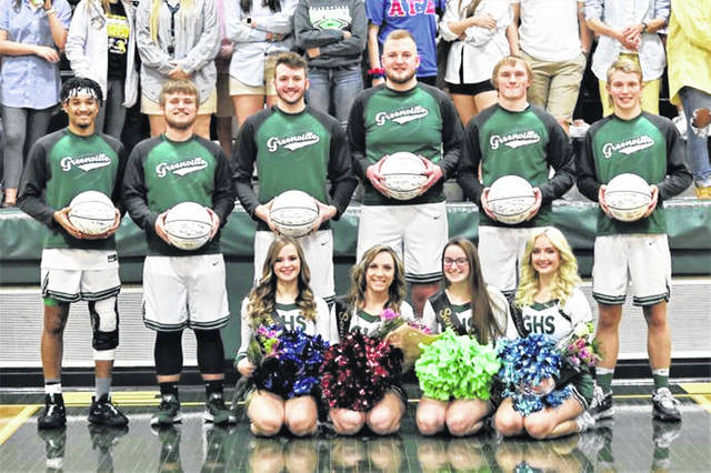 Greenville basketball players and cheerleaders are honored on senior night.