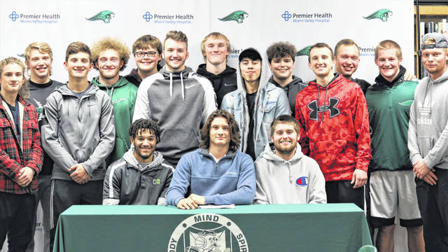 Greenville football players and friends join John Butsch at his college signing to play football for Tiffin University.