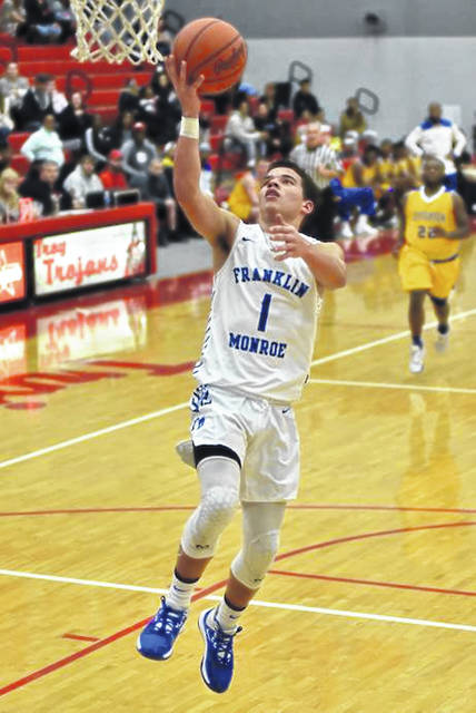 Ky Cool drives to the basket for Franklin Monroe in the Jets come-from-behind tournament win over Jefferson.