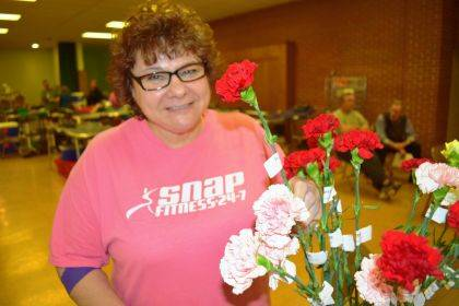 Donor Angela Penny is shown with carnations at 2019 Zechar Bailey blood drive.