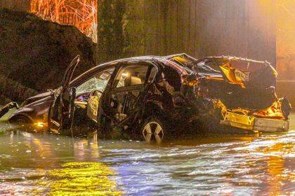 The car Justin Miller was driving traveled through a guard rail and over the edge of a bridge to land in the middle of the Greenville Creek.
