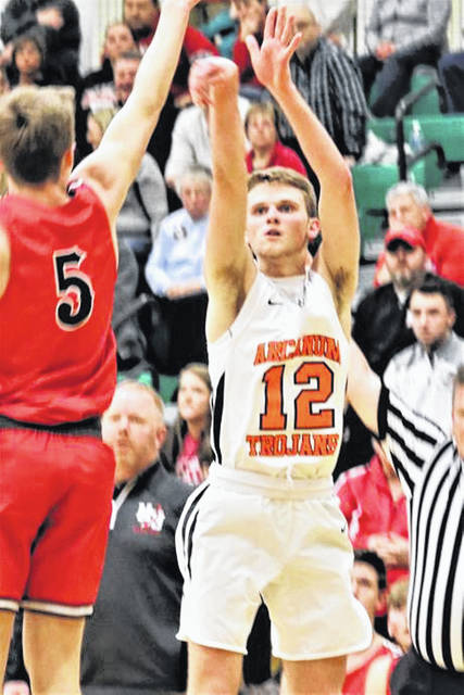 Arcanum senior Carter Gray puts up a jumper in his final high school basketball game.