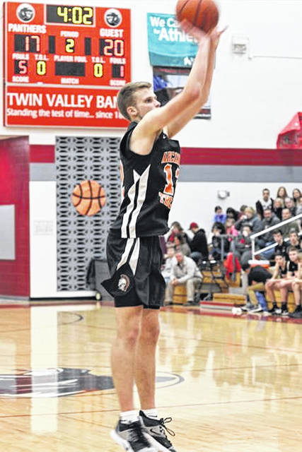 Carter Gray launches a 3-pointer for Arcanum in Friday night CCC game at South.