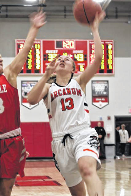 The Lady Trojans' Elliana Sloan drives the lane in the team's win over the Lady Indians.