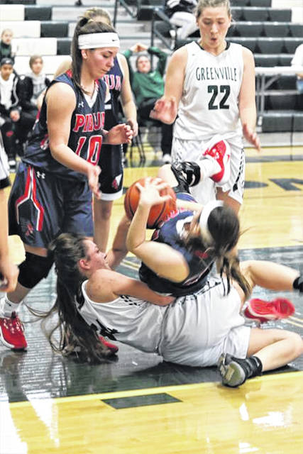 Greenville's Emalee Bowling battles for a loose ball while Lily Hayes looks on in the Lady Wave JV's win over Piqua.