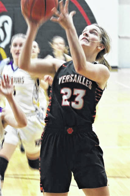 Emma George scores for Versailles in the team's Tuesday night tournament win over Dayton Christian.