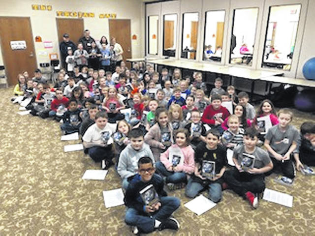 Grangers shown behind the Arcanum third-graders who received dictionaries are Dean Burk, Harvey Hinshaw, Susan Gunckle, Lynne Hinshaw and Junior Grangers, Calen Clopp, Moxon Gilpin, Madelyn Dillon, Haddie Gilpin and Joey Clopp.