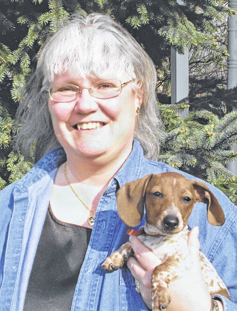 Ruth McDaniel, acting president of the Darke County Humane Society, is shown here with her fur	girl, Daisy Mae.