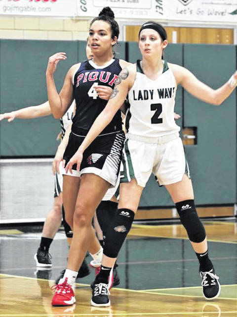 the MVL's two leading scorers, Piqua's Tylah Yeomans and Lady Wave's Haleigh Behnken battle for position in the team's Saturday game at Greenville.