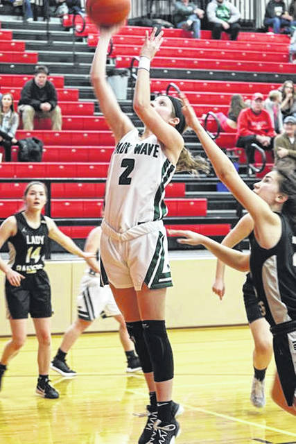 Haleigh Behnken scores two of her game high 22-points for Greenville in the Lady Wave's OHSAA DII tournament win over the Benjamin Logan Raiders.