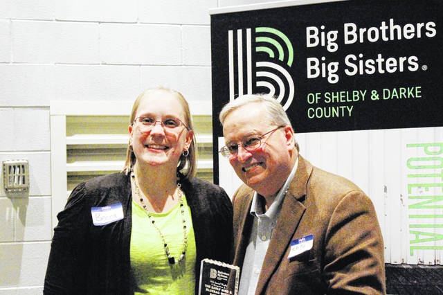Keith Foutz, right, stands with Darke County Big Brothers Big Sisters Coordinator Becca Cotterman. Foutz was awarded the Friends of the Big Brothers Big Sisters Award for Darke County at the organization's volunteer appreciation dinner Thursday evening.
