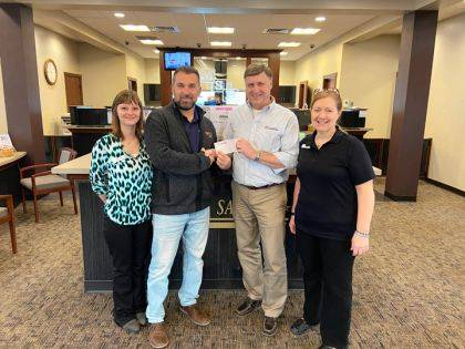 Pictured is Eric Fee, Empowering Darke County Youth, accepting a check from Tim Burns, Mercer Savings Bank's Greenville branch manager. Also shown are Sabrina Hull and MaryAnn Ridenour.