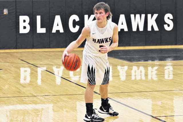 Max Dirmeyer looks for an open man in the Blackhawks Saturday night non-conference home game with Fort Recovery.