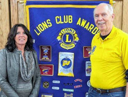 Pictured are Darla Erwin from Randolph Nursing and Rehabilitation and Union City Lion Owen Griffith.