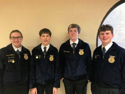 The Versailles Ag Sales team includes Laura Wuebker, Luke Winner, Payton Niekamp and Dalton Hesson.