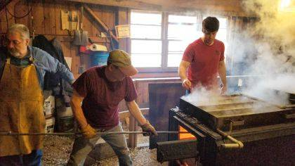 Volunteers Rick Normile and Neil Schmidt are hard at work with Michael Colamarino boiling sap in the sugar shack.