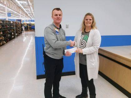 Walmart Store Manager CJ Sharpe presented a check to BBBS Executive Director Jennifer Bruns.