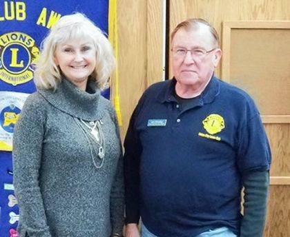 Paula Key is shown with Lion Program Chairman Len Hindsley.