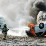 Car catches fire in rollover crash