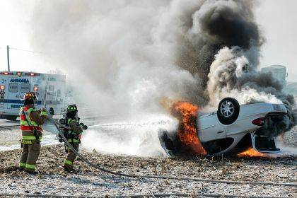 The Ansonia Fire Department worked to put out the blaze after the car rolled over and caught fire.
