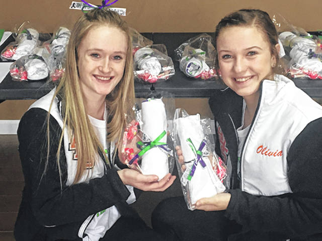 Courtesy photo Hailey Sager, a sophomore at Arcanum-Butler High School (left) is pictured with Olivia Shaffer holding items for the We Are The Majority Cheer Day.