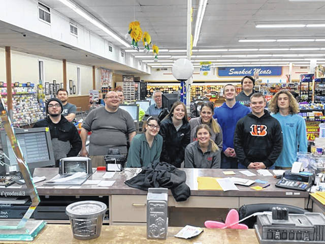 Courtesy photo Hometown Pride was showcased recently at Eikenberry's IGA as employees who had already worked earlier that day, sacrificed an evening to deep clean surfaces to combat COVID-19 and restock shelves.