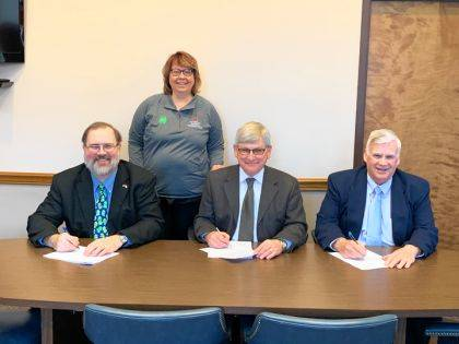 Darke County Commissioners Matt Aultman, Mike Rhoades and Mike Stegall joined OSU Extension's Rhonda Williams to sign a proclamation declaring Ohio 4-H Week.