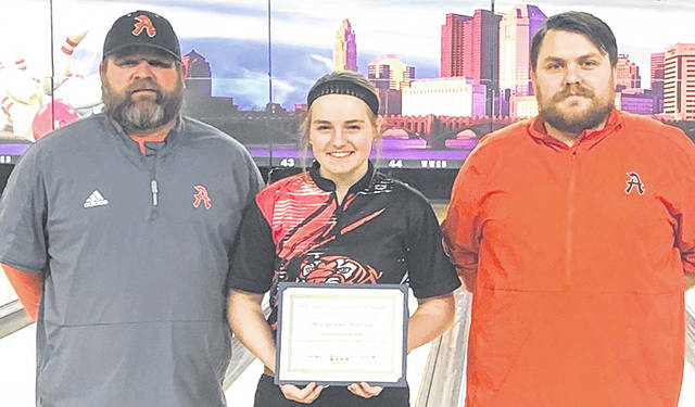 Makenzie Singer earned All Ohio D2 honorable mention in bowling. She is shown here with her Ansonia coaches, T.J. Phlipot, on the left, and Tyler Studabaker.