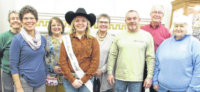 The Annie Oakley (AO) Center Foundation has increased the prize money for this year's Annie Oakley Shooting Competition. Among those on hand to receive the news were, front row from left, Eileen Litchfield, 2019 Miss Annie Oakley Madison Werner, Chris Hunt and Pat McCarthy, and back row, Brenda Ballengee, Annie Oakley Festival Chair Jo Ellen Melling, AO Foundation Director Nancy Cooper and Mike Ross. In addition to Cooper, Litchfield, Ballengee, McCarthy, Hunt and Ross are members of the foundation. Litchfield holds in her left hand a phone in which foundation members Cathy (Annie of Great Lakes) and John Wagner were on during a conference call at the foundation meeting that night. A photo which had Bonnie Perry on it, was placed in Litchfield's pocket.