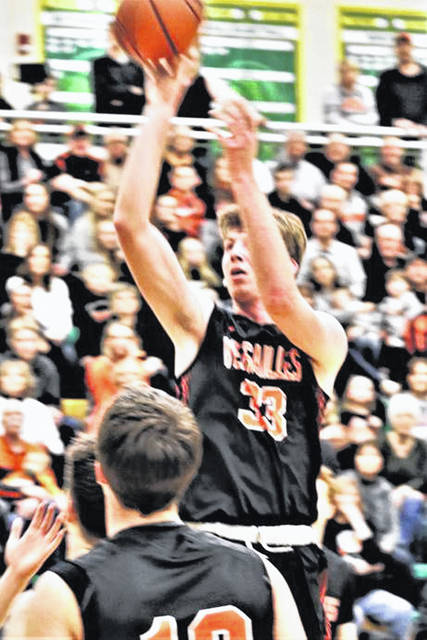 Versailles Austin Toner shoots during a Division III district final on Saturday at Northmont High School's Thunderdrome.