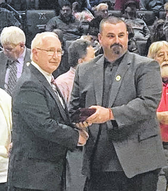 Gaylen Blosser accepted his award from Matt Macy, athletic administrator at Ansonia High School.