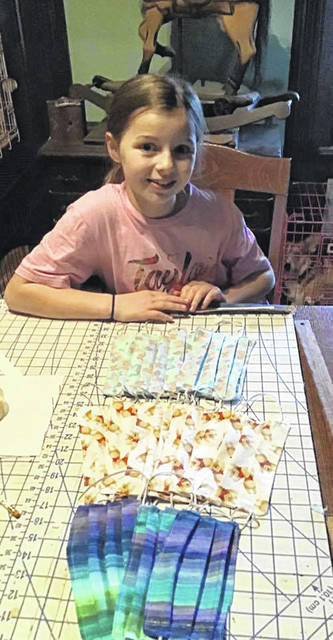 Allie Bergman, a third-grade student at Versailles, learned how to sew and enjoyed making face masks with her grandmother, during the school shutdown.