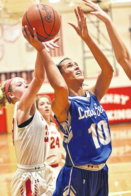 OHSAA First Teams All-Ohio Corina Conley drives to the basket for Franklin Monroe.
