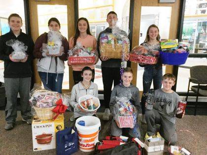 The raffle items are pictured with some of the Mississinawa Valley seventh graders.
