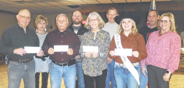 On hand for the distribution of money to four organizations at the Eagles Lodge were, from left to right, Gordon Smith and Kim Rudnick of the Friends of Bears Mill; Tom Jenkins of Greenville Boys and Girls Club; Eagles President Rick Robinson; Kay Sloat of Empowering Darke County Youth; Eagles member Steve Fowble; 2019 Miss Annie Oakley Madison Werner; Eagles member Craig Thompson; and Werner's mother, Marla Blume.