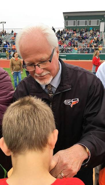 Jim Troutwine, Troutwine Auto Sales, served as an awards presenter at last May's Track and Field Event. He is presenting a ribbon to Michael Meade of Mississinawa Valley Schools.