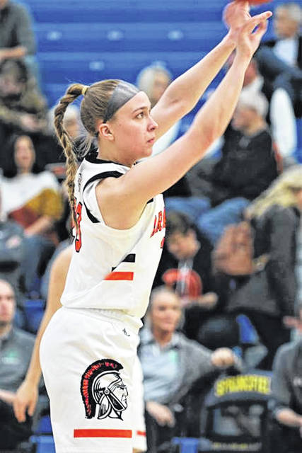 Kayla O'Daniel takes a shot for Arcanum in the Lady Trojans district tournament game with Anna.