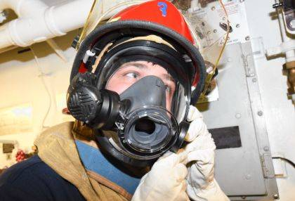 NORFOLK, Va. – Damage Controlman Fireman Blaine Norton, from Greenville, put a helmet on during a simulated fire drill aboard the Arleigh Burke-class guided-missile destroyer USS McFaul (DDG 74). McFaul is currently underway and is part of Destroyer Squadron (DESRON) 26, the surface warfare commander for Carrier Strike Group (CSG 10).