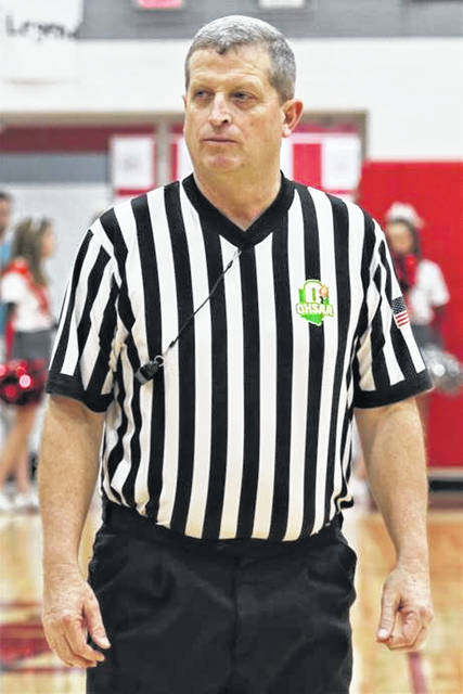 Paul Armstrong officiates a 2019-2020 Ohio High School Athletic Association varsity basketball game