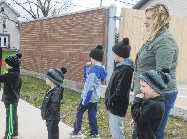 Marissa Dillman brought her blended family of five sons — a second-grader, two kindergarteners and two pre-schoolers — to the parade through town on Monday.