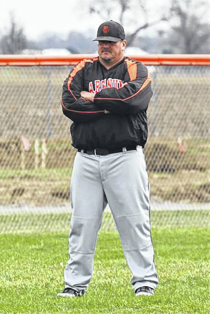 Arcanum Hall of Fame baseball coach, Randy Baker takes up his third base coaching position.
