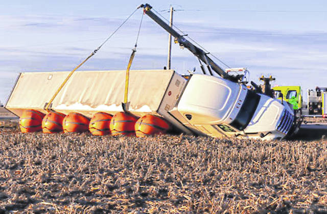 Heavy equipment was used to clear a damaged semi-tractor and trailer after a crash Sunday afternoon.