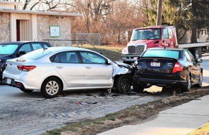 The driver of this Kia Rio reported minor injuries after they lost control and smashed into a parked Ford Fusion.