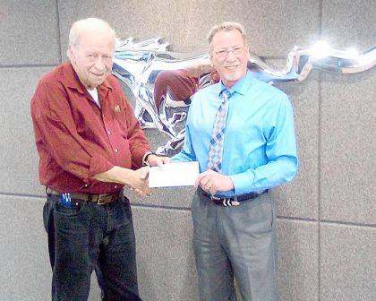 Shown is Bob Robinson, executive director of Empowering Darke County Youth, accepting a check from Dave Knapp, owner of Dave Knapp Ford Lincoln.